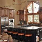 The Colorado kitchen AFTER renovation show the combination of stained and rubbed finishes used in the kitchen.