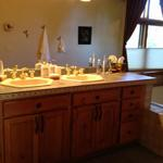 The Colorado master bath BEFORE shows how closely spaced the sinks were located.