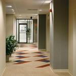 Sun Refining & Market Company elevator corrdior with light finishes and graphic carpet tile designs.