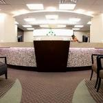 Tulsa OBGYN medical offices are designed to follow simple architectural curves to provide comfort for their client's.  The reception is centerd on the entrance and greets Tulsa OBGYN clients.  The carpet patterns are designed to bring the center of attention the check-in reception desk.