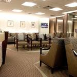 The waiting area of Tulsa OBGYN has custom design seating and upholstery all to complement the architectural curves of the waiting area and the reception desk.  The colors are fresh and warm and the lighting is crisp.