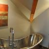 A Colorado master bathroom retreat complete with custom copper and polished nickel tub with a freestanding tub filler